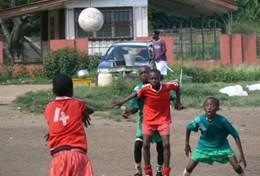 A group of young boys in Ghana play a football match together using the skills taught to them by one of our volunteers.