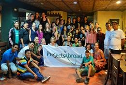 School Sports volunteers and local Projects Abroad staff pose with a team of sports players in the Philippines.