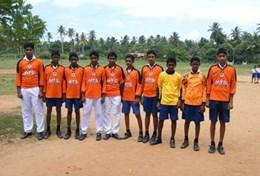 A team of sports players in Sri Lanka prepares for a lesson as part of our volunteer School Sports project.