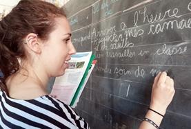 A Teaching volunteer uses a blackboard to teach school children at one of our placements in the South Pacific.