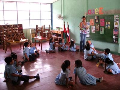 'A volunteer teaches her pupils the names of colours at a school in Costa Rica, Latin America.