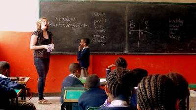 A Projects Abroad volunteer teaches English to her class in Ethiopia, Africa
