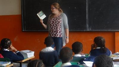 A Projects Abroad volunteer reads to her class in Ethiopia, Africa