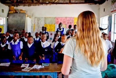 Children listening to their volunteer teacher in one of the rural schools in Kenya
