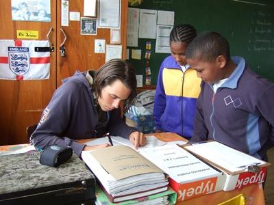 A teaching volunteer in South Africa helps a local student
