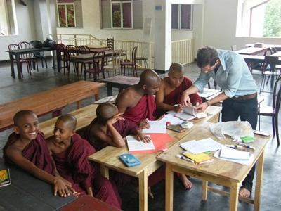 A volunteer teaches young monks in a classroom in Sri Lanka, Asia.